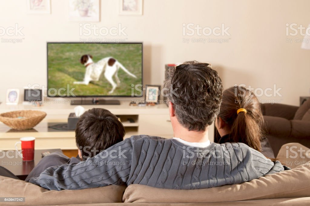 family watchin tv stock photo