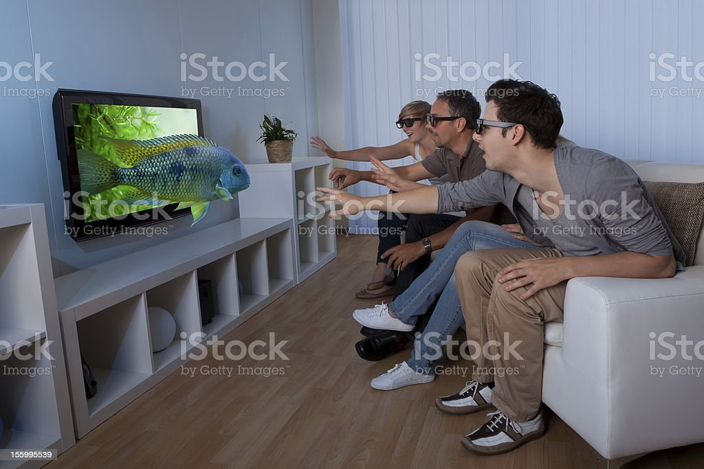 Family watching 3D television stock photo