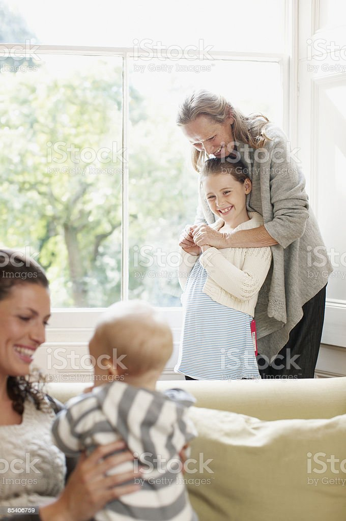 Family watching baby royalty-free stock photo
