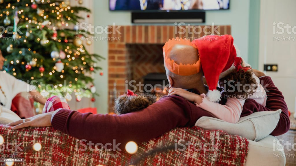 Family Watching Christmas Television stock photo