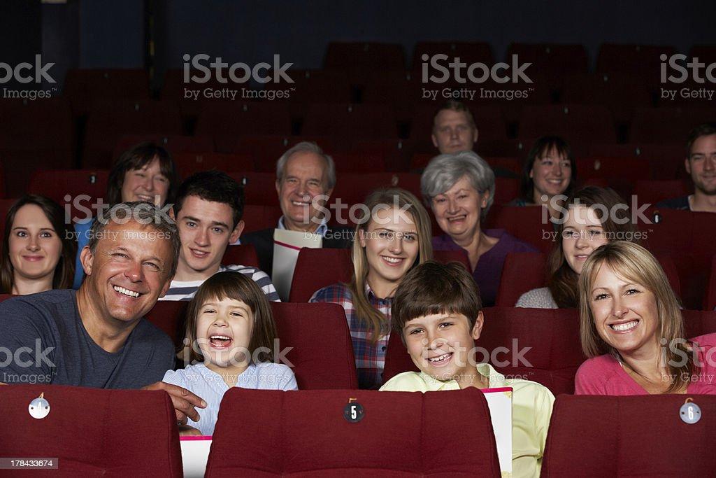 Family Watching Film In Cinema stock photo