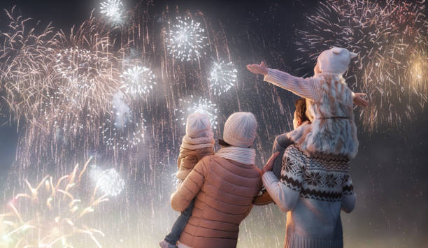 family watching fireworks stock photo