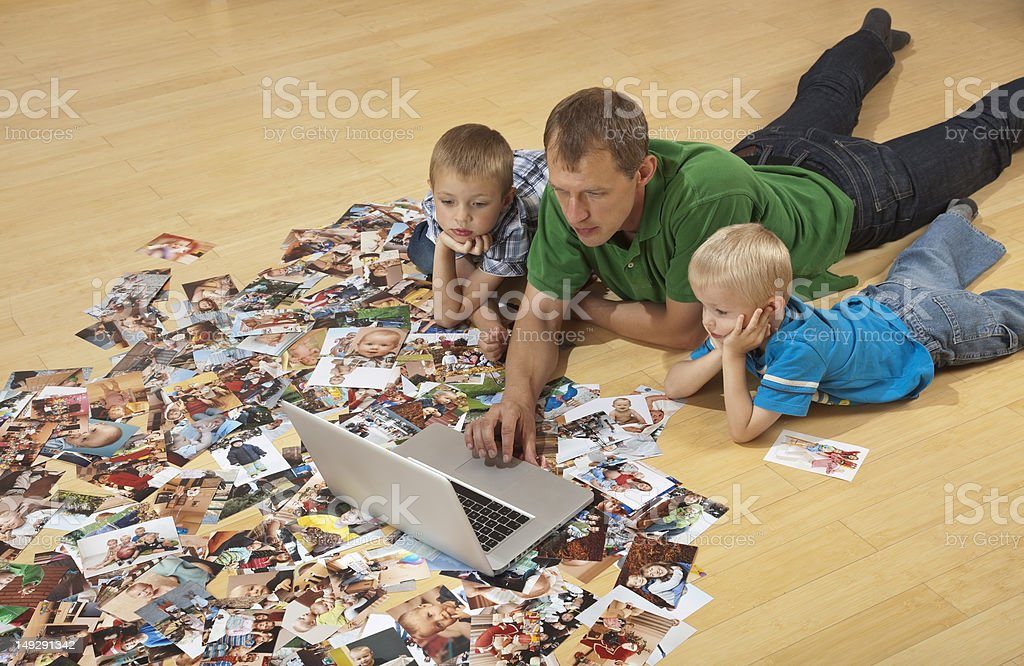 Family watching laptop on the floor royalty-free stock photo