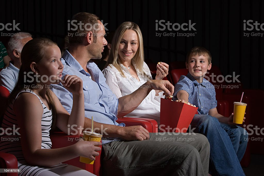Family watching movie at the movie theater royalty-free stock photo