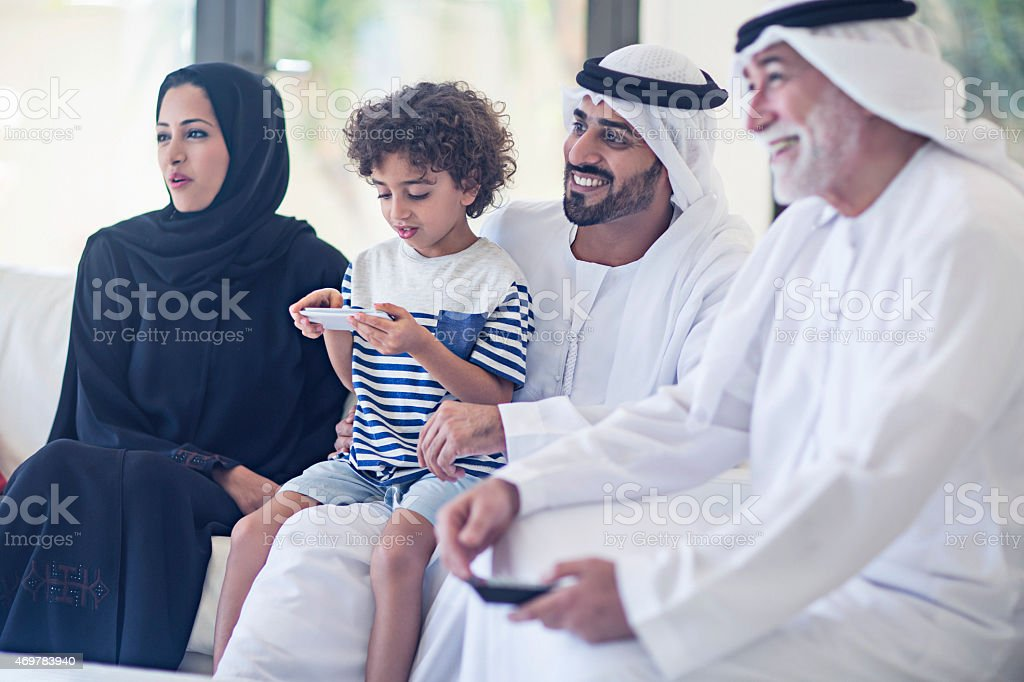Family watching television stock photo