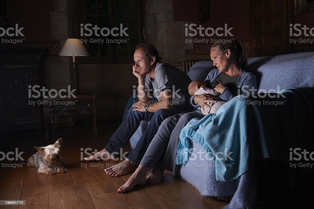Family watching television together stock photo