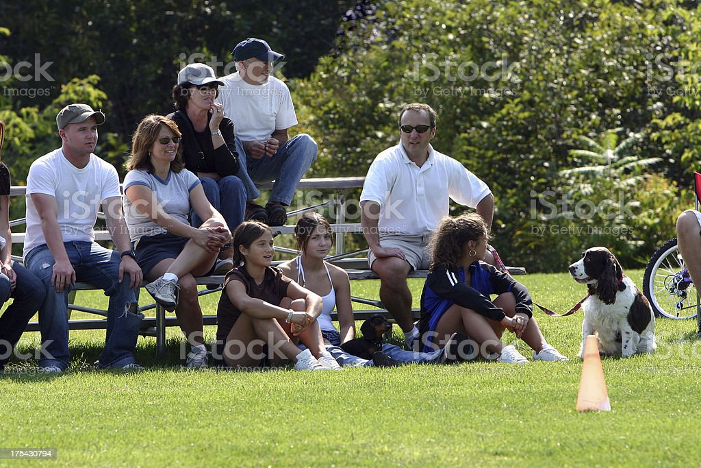 family watching the game stock photo