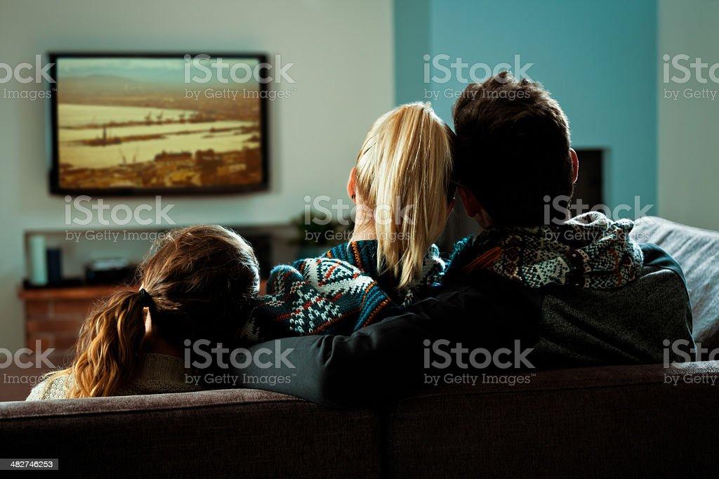 Family watching TV stock photo