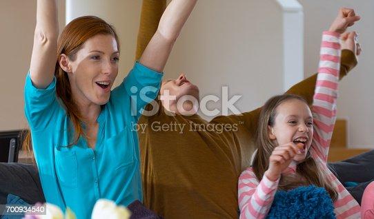 istock Family watching TV 700934540