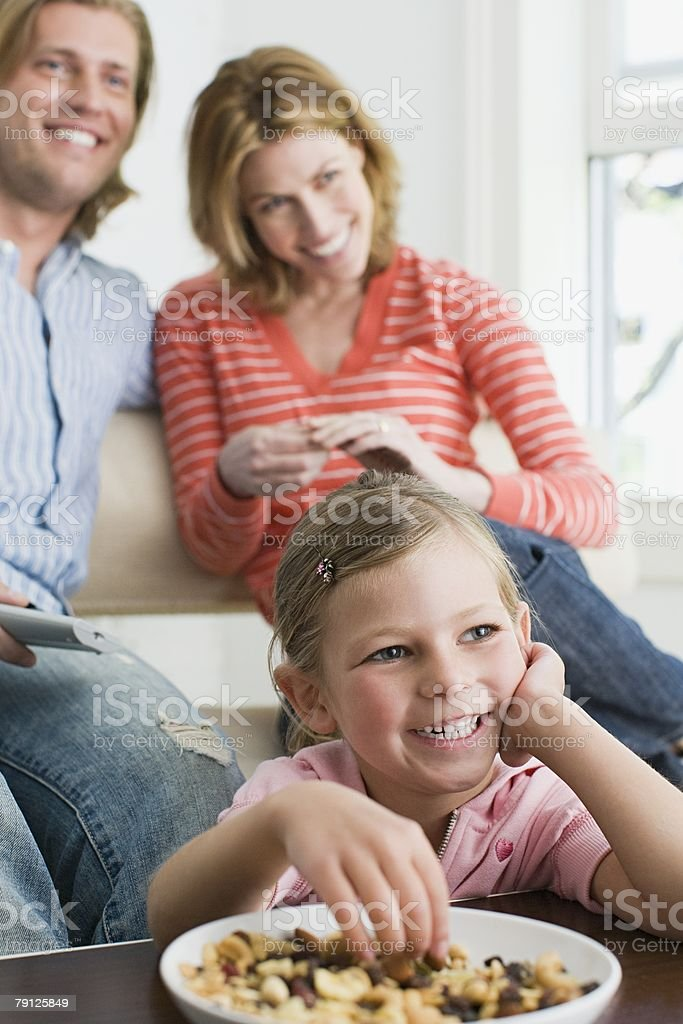 A family watching tv royalty-free 스톡 사진