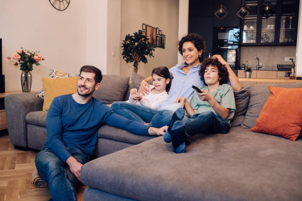 Family watching TV show stock photo