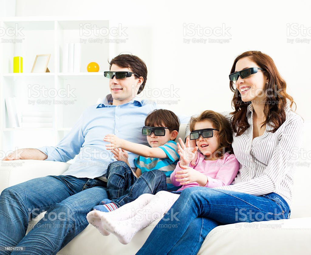 Family Watching TV With 3D Glasses royalty-free stock photo
