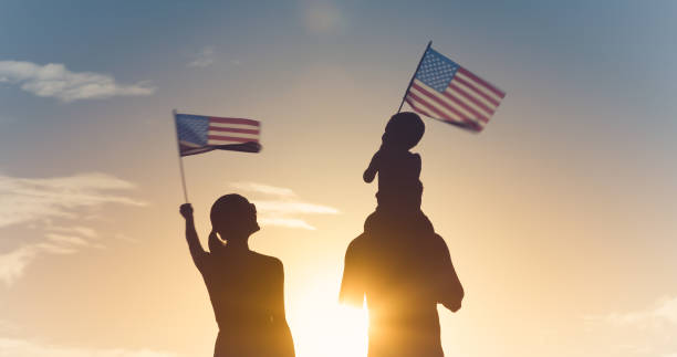 Family waving American flags stock photo