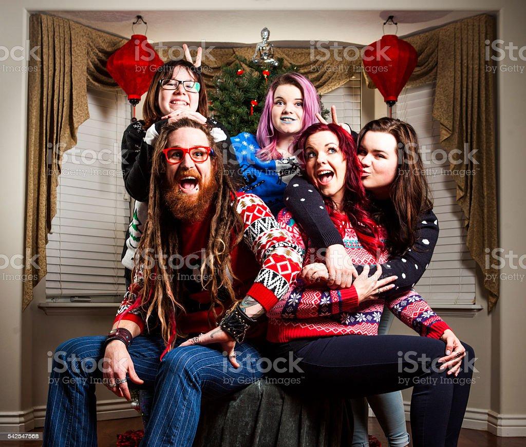 Family Wearing Cheesy Christmas Sweaters Royalty Free Stock Photo