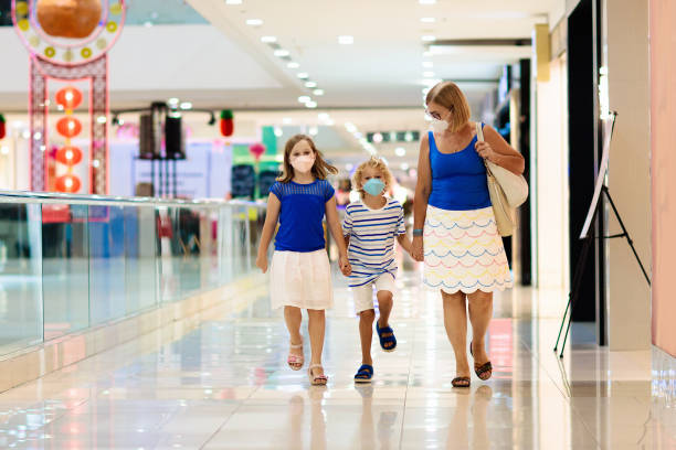 Family wearing face mask in shopping mall in Asia stock photo