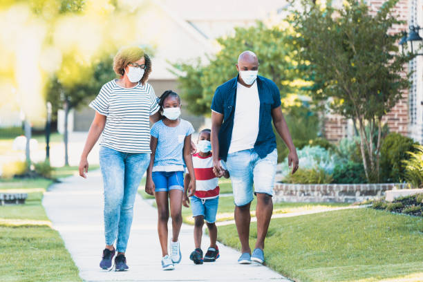Family wears face masks during COVID-19 pandemic stock photo