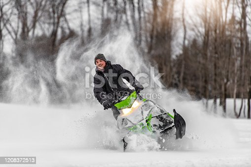 A family day of sliding in the mountains in winter, Quebec, Canada