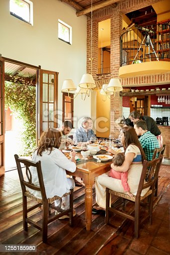 Shot of multi-generation family having weekend lunch together at home