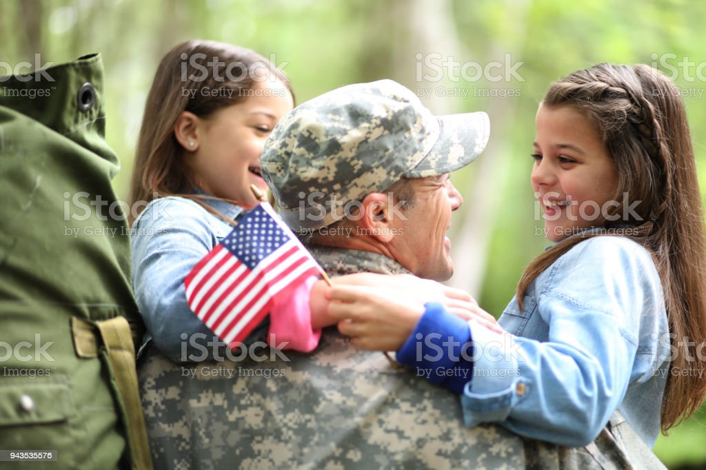 Family welcomes home USA army soldier. stock photo