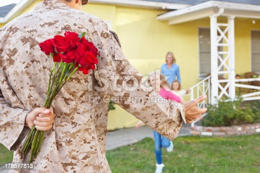 istock Family Welcoming Husband Home On Army Leave 178577813
