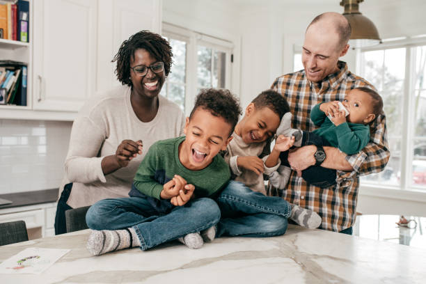 family with 3 little kids Parents and 3 kids at home mixed race person stock pictures, royalty-free photos & images