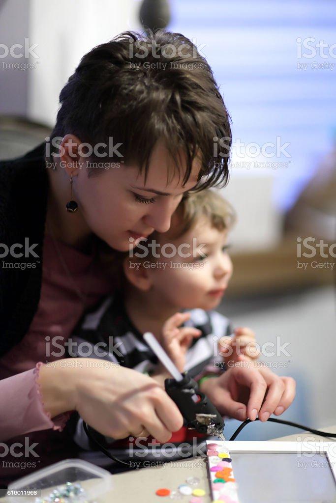 Family with a glue gun stock photo