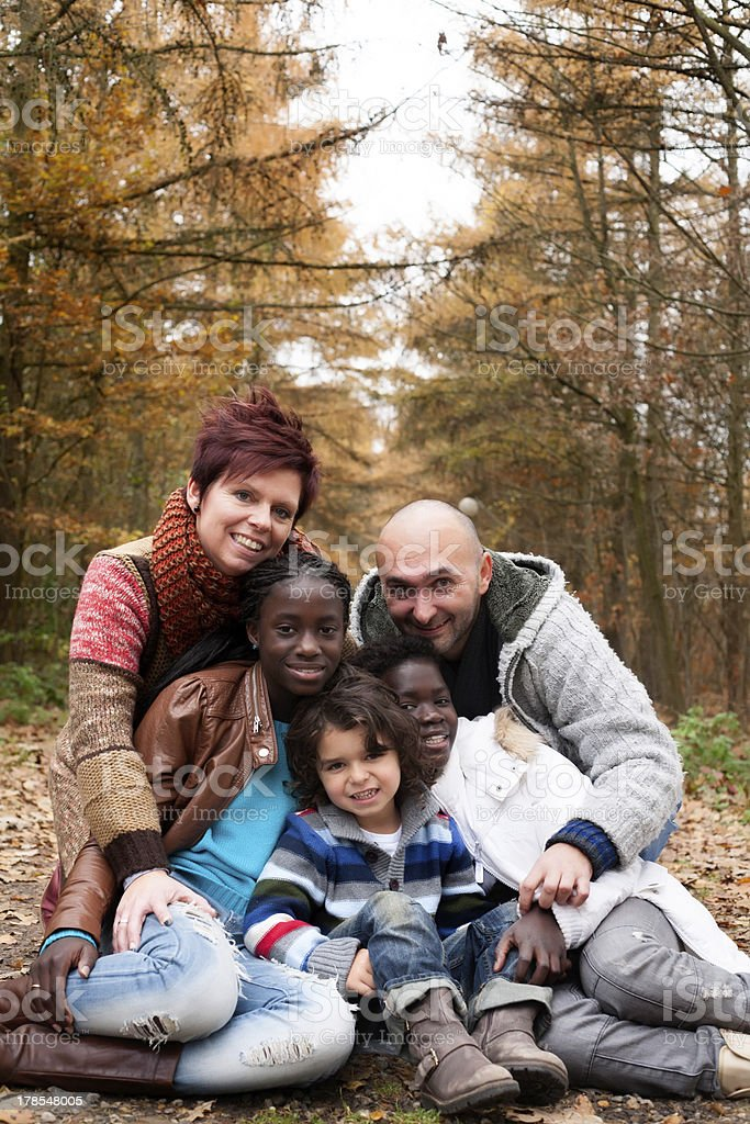 Family with adopted children stock photo