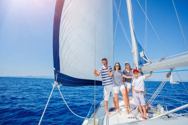 family with adorable kids resting on yacht - enjoying wealthy life imagens e fotografias de stock