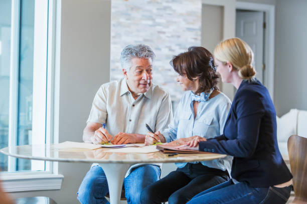 family with adult daughter working on home finances - will stock photos and pictures