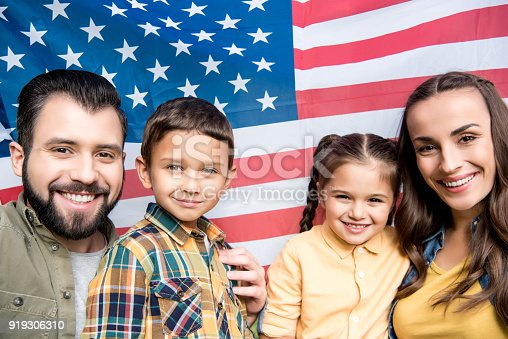istock family with american flag 919306310