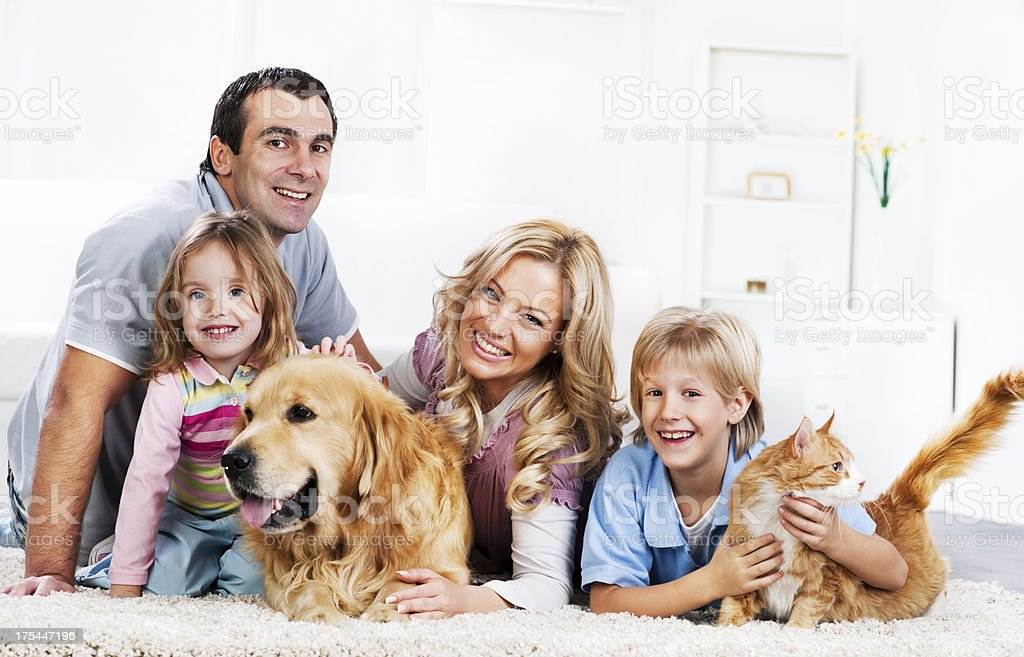 Family with animals sitting on the carpet royalty-free stock photo