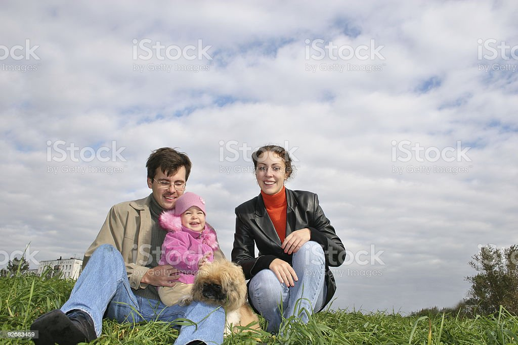 family with baby and dog on grass royalty-free stock photo