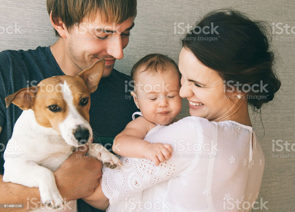 Family with baby and pet dog stock photo