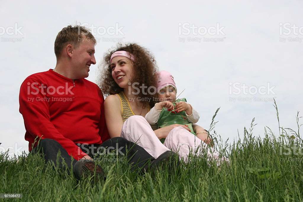 family with baby on grass royalty-free stock photo