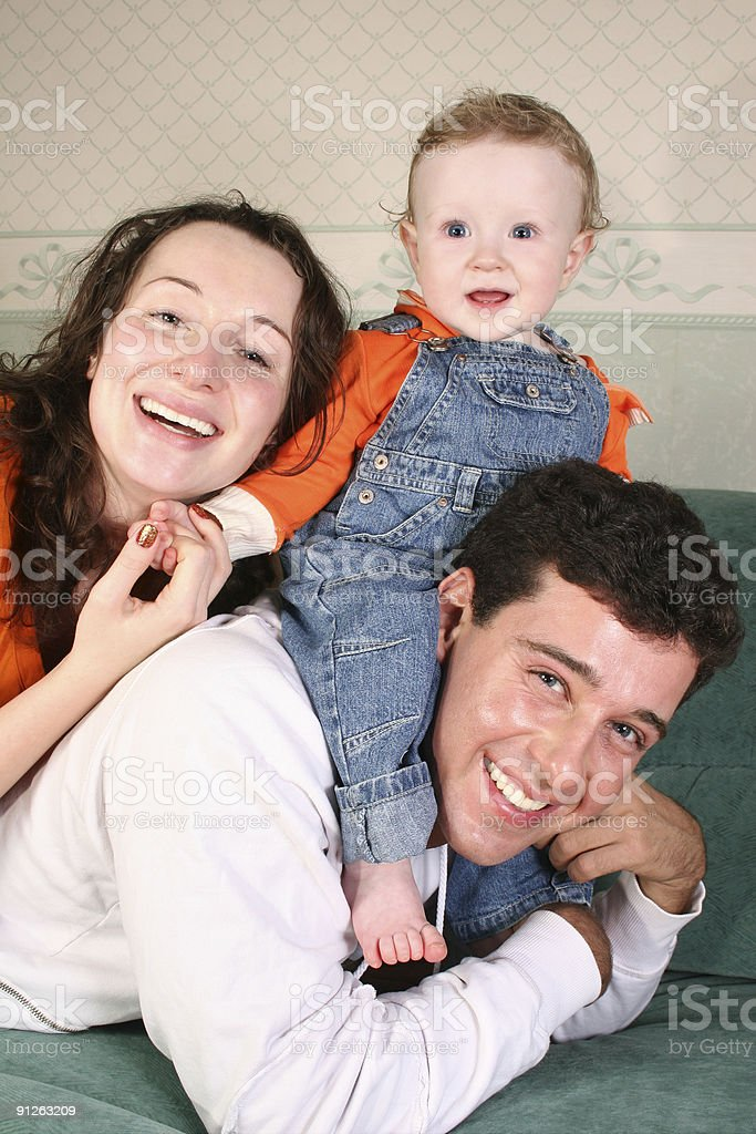 family with baby on sofa royalty-free stock photo