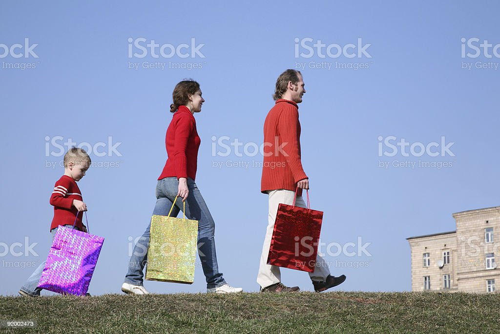 family with big bags on meadow royalty-free stock photo