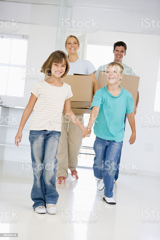 Family with boxes moving into new home royalty-free stock photo