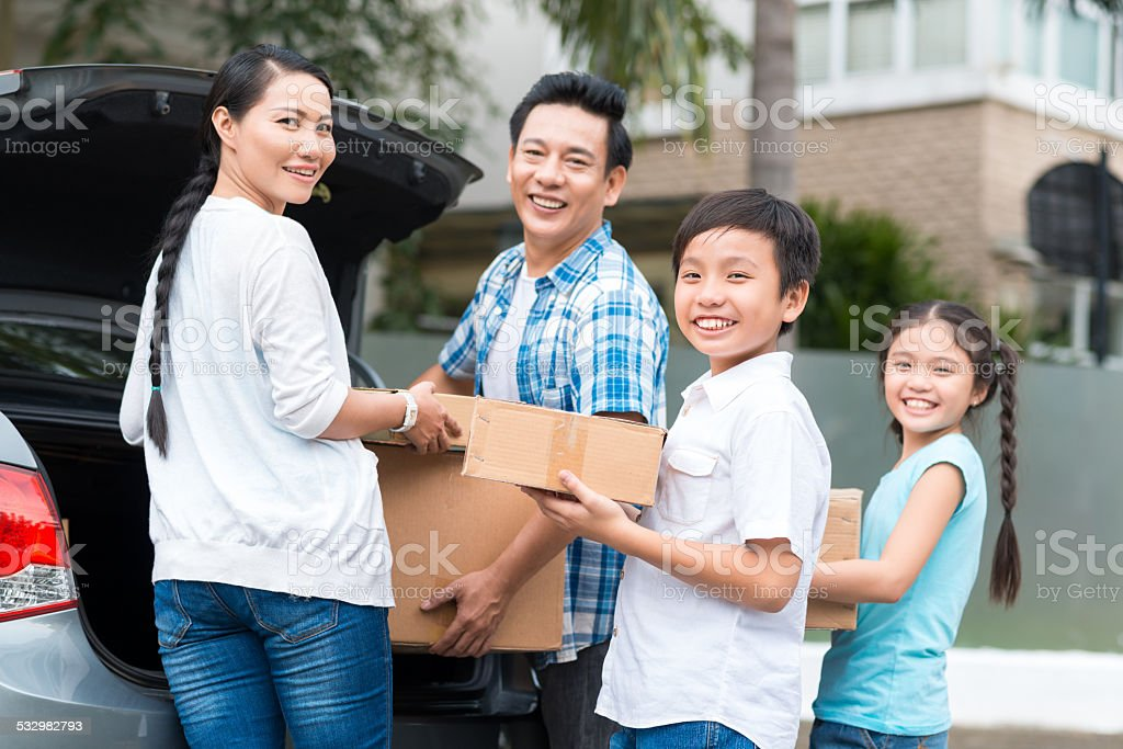 Family with cardboard boxes stock photo