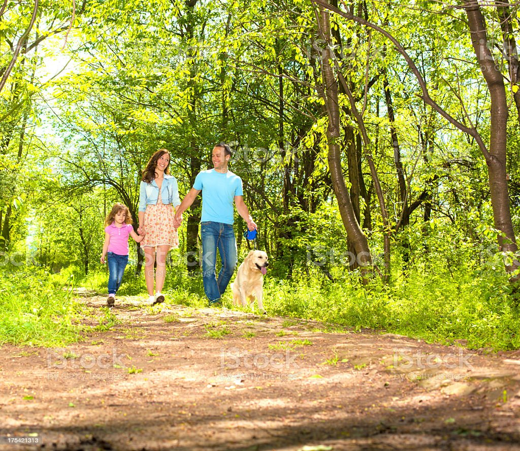 Family With Child and dog Walking Outdoors. stock photo