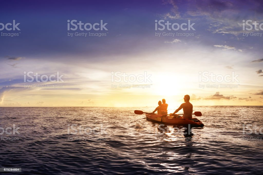 Family with child swims on kayak stock photo
