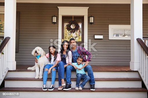 istock Family With Children And Pet Dog Sit On Steps Of Home 904483218