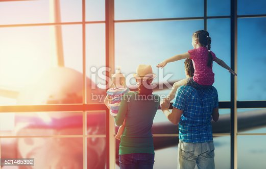 istock family with children at the airport 521465392