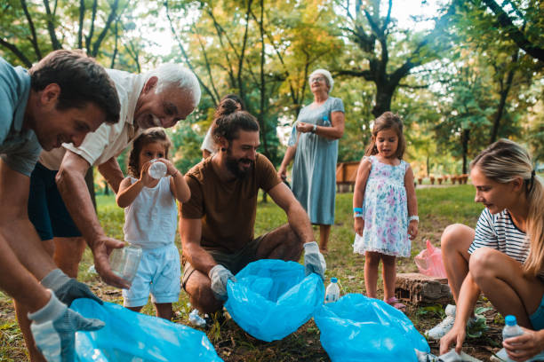 Family with children collecting garbage stock photo