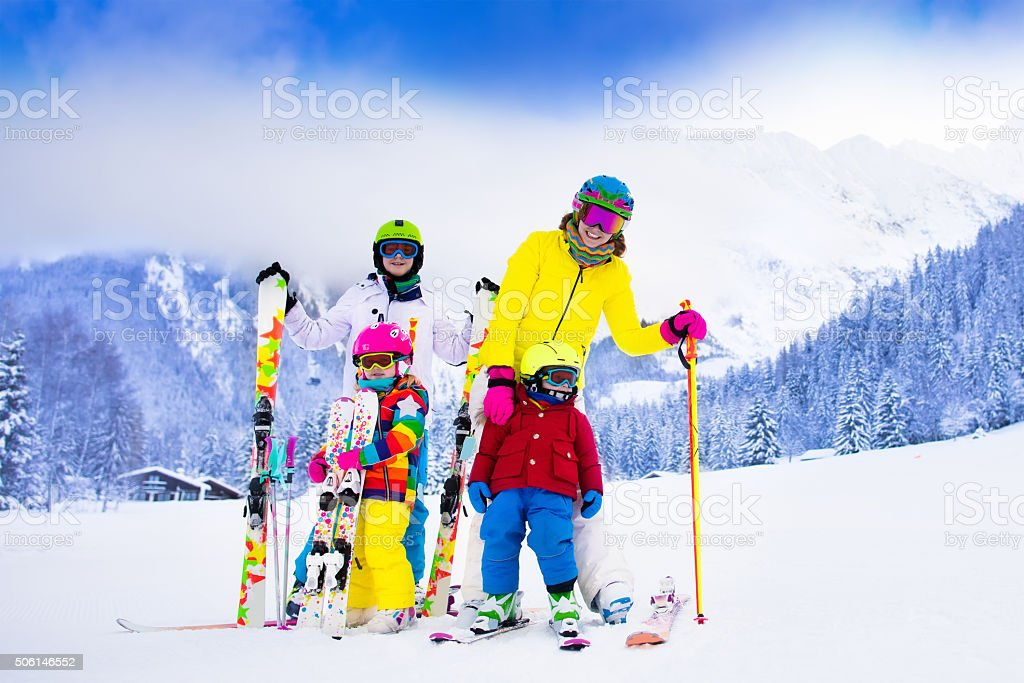 Family with children on winter ski vacation stock photo