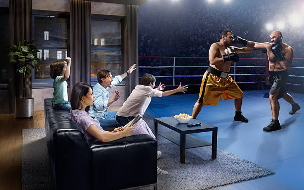 Family with children watching Boxing on TV stock photo