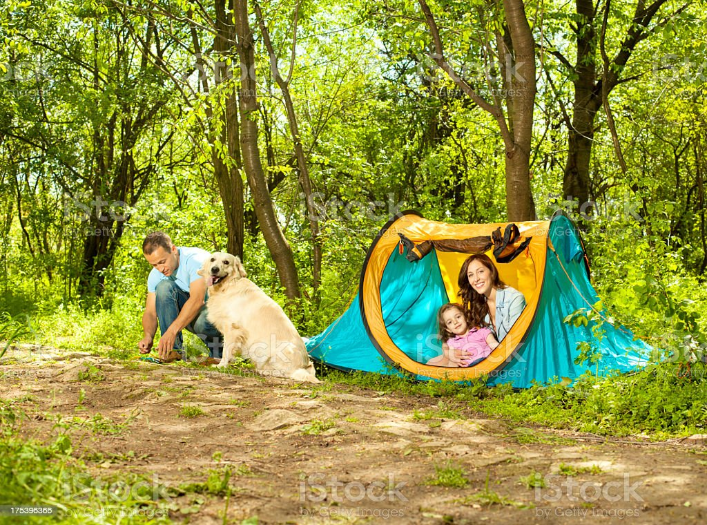 Family With Dog Camping Outdoors. royalty-free stock photo