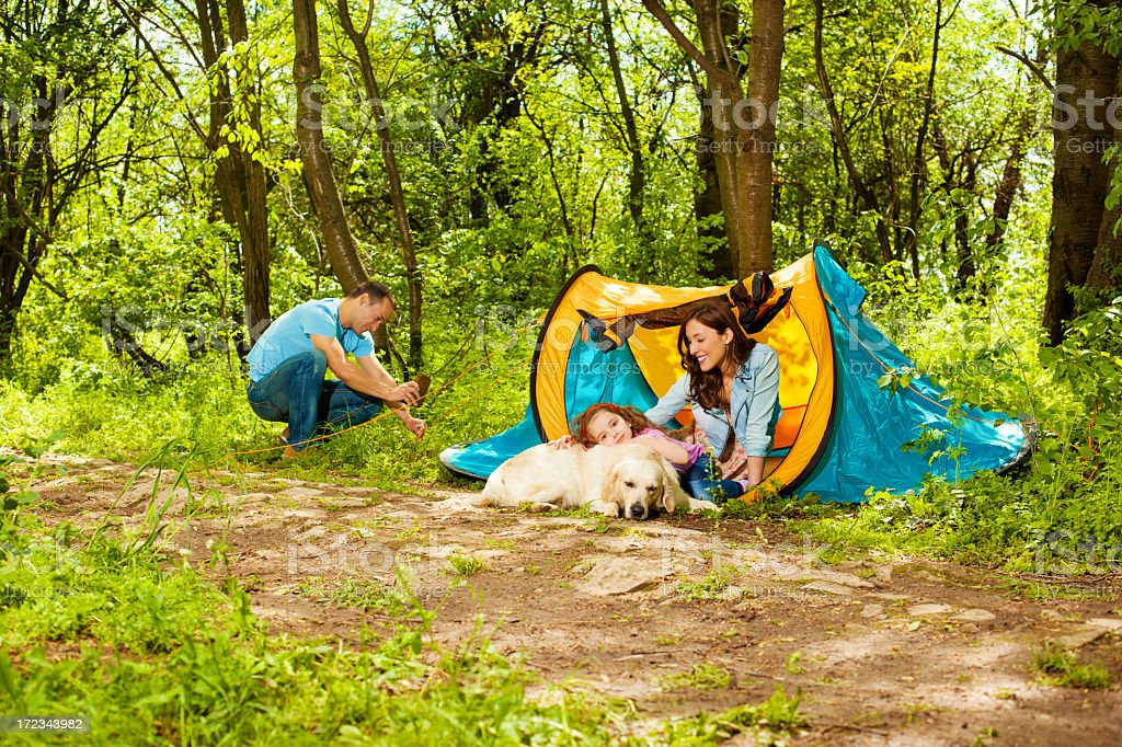 Family With Dog Camping. royalty-free stock photo