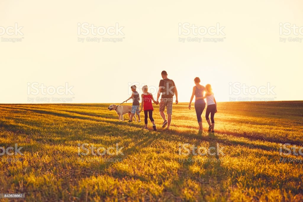 Family with dog on the trip stock photo