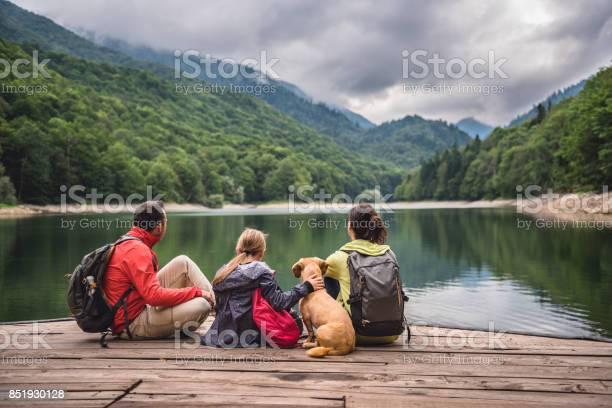 Family with dog resting on a pier picture id851930128?b=1&k=6&m=851930128&s=612x612&h=4dobdyld36iaaltskjk63th2hzf5tryjvjdnzuemtrm=