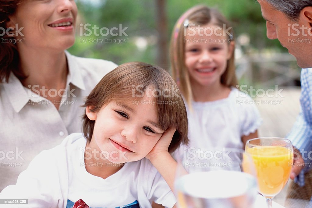 Family with drinks outdoors royalty-free stock photo